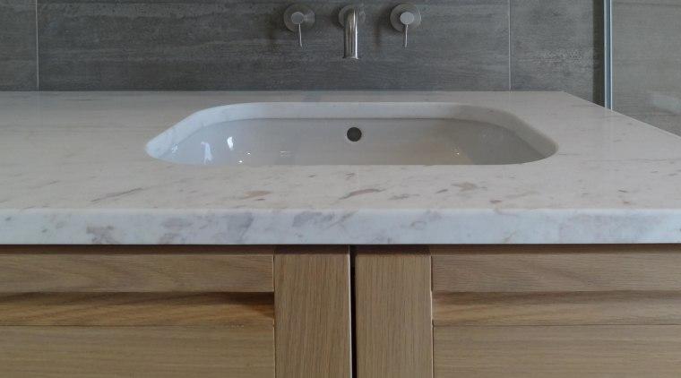 An industrial look is warmed up by soft bathroom sink, countertop, plumbing fixture, sink, gray, brown