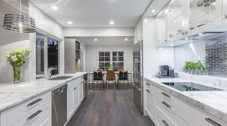 This reinvented kitchen by designer Kira Gray offers countertop, interior design, kitchen, real estate, gray