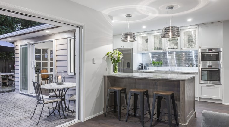 This new kitchen in a traditional home by countertop, interior design, kitchen, real estate, gray