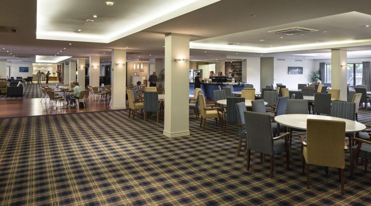 Extensive facilities at The Poynton retirement village include floor, flooring, institution, interior design, lobby, restaurant, brown