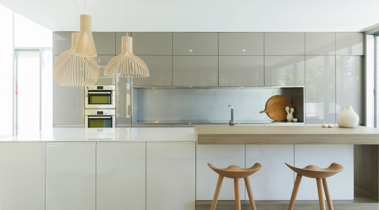 Sleek finishes, touches of wood, and recessed handles cabinetry, countertop, cuisine classique, interior design, kitchen, product design, white, gray