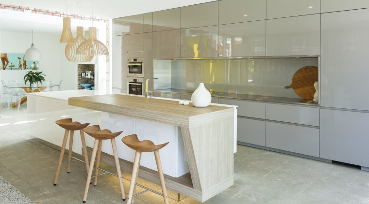 For this kitchen designed by Nancy Frost, the countertop, cuisine classique, floor, flooring, interior design, kitchen, real estate, table, white, gray