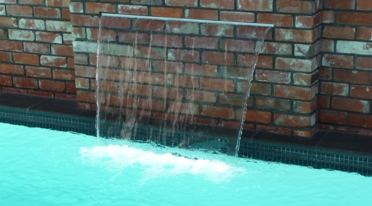 This Mayfair pool includes a 1200mm-wide water feature. brick, swimming pool, wall, water, water feature, teal, black
