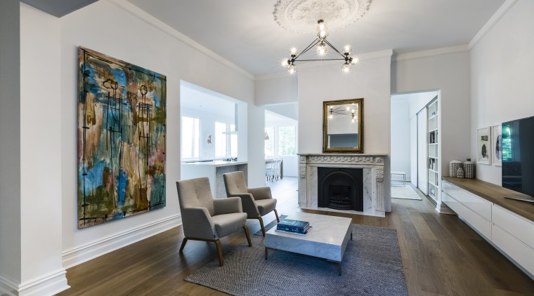 The big picture  a cental fireplace provides ceiling, estate, floor, flooring, home, interior design, living room, property, real estate, room, gray