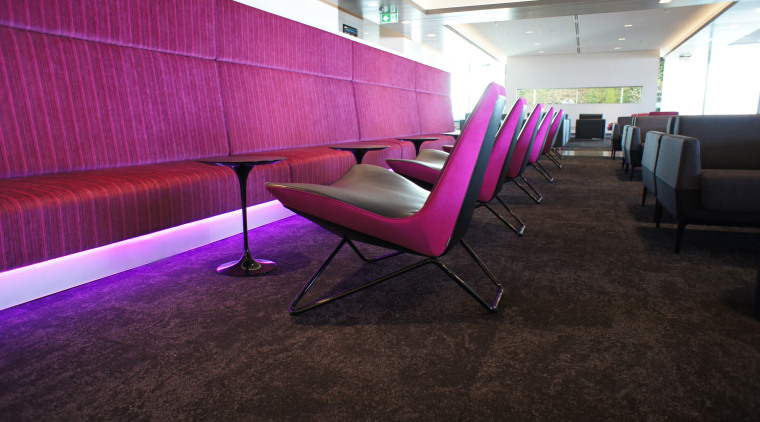 The new Air New Zealand International Lounge at architecture, chair, floor, flooring, furniture, interior design, purple, table, wall, black