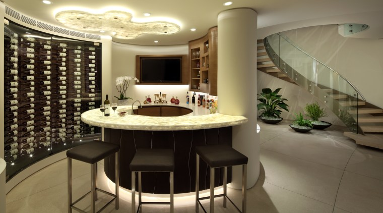 This temperature-controlled wine storage separates from the bar ceiling, interior design, lobby, brown