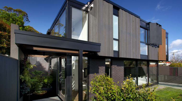 Inner landscape  this home by architect Ernie architecture, building, facade, home, house, property, real estate, residential area, black
