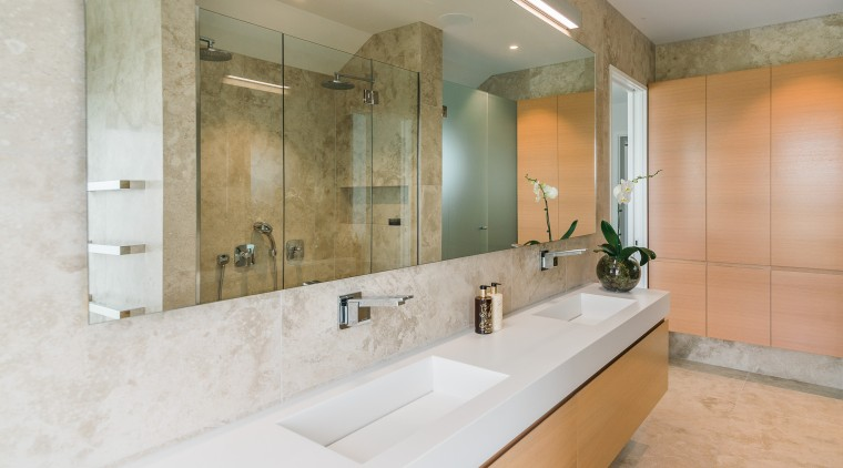 Handleless wall cabinetry provides unobtrusive storage in this bathroom, home, interior design, real estate, room, tile, gray