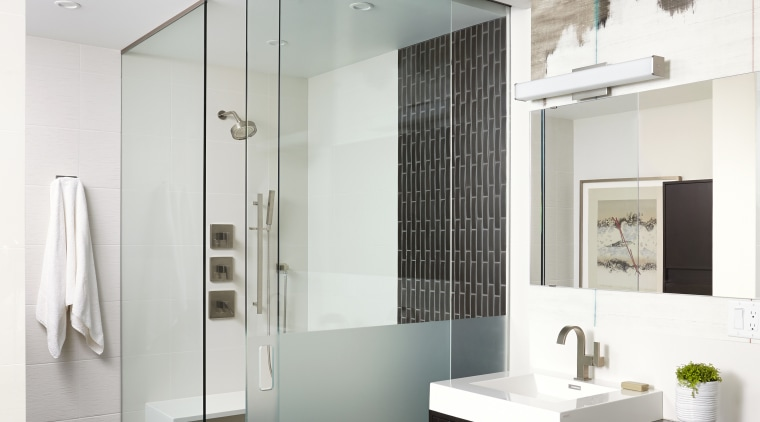 In this apartment project, the master suite shower bathroom, floor, interior design, sink, gray, white