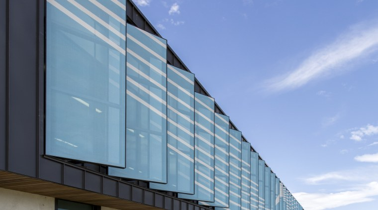 Custom shade screens on Synlaits new administration building architecture, building, commercial building, corporate headquarters, daytime, facade, headquarters, house, sky, teal
