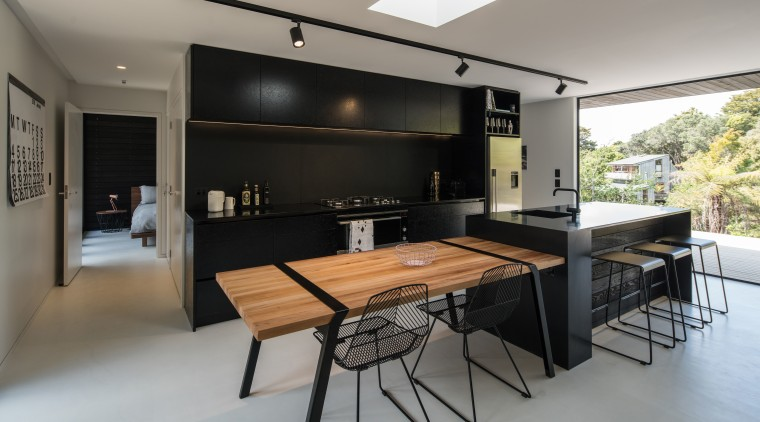Versatile agenda this free-standing wood table looks like house, interior design, kitchen, real estate, table, gray, black