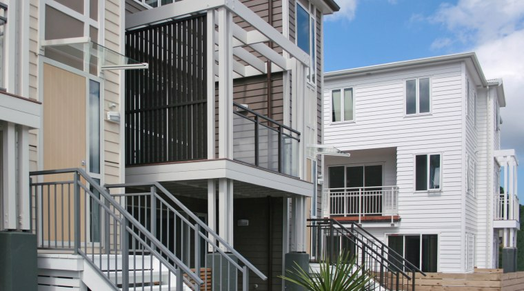 The Edge system from HomePlus features in the apartment, balcony, building, condominium, elevation, facade, handrail, home, house, mixed use, neighbourhood, property, real estate, residential area, siding, window, gray
