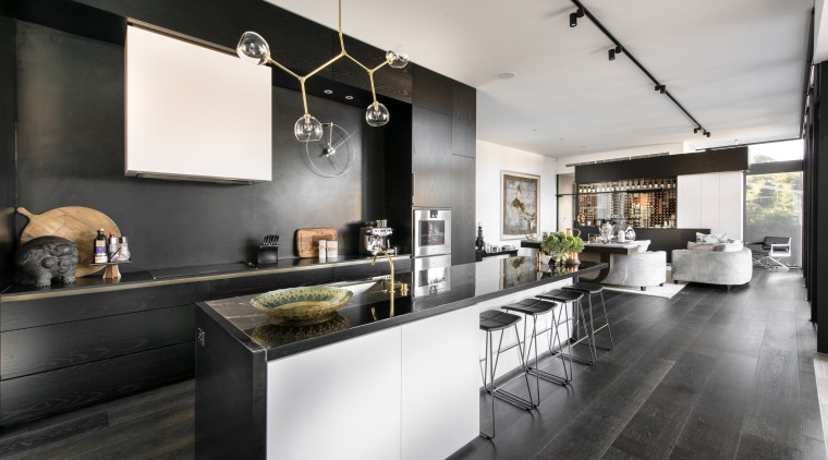 The top NABD award for 2015 Best Alteration/Addition countertop, interior design, kitchen, loft, black, white
