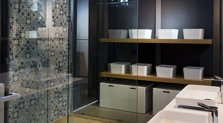 This double basin vanity is cantilevered off the bathroom, countertop, interior design, black