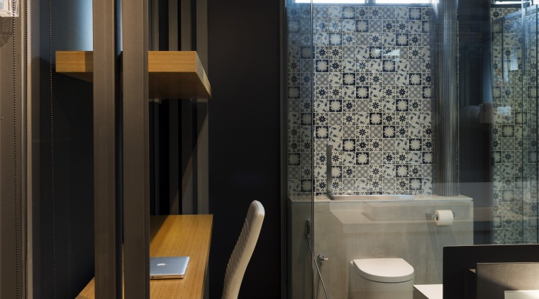 A set of shelves to the side of architecture, bathroom, interior design, public toilet, room, black