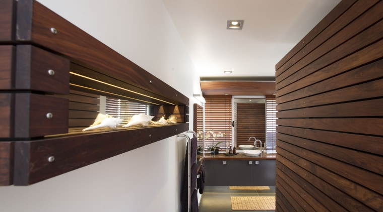 Macrocarpa battens on a custom shelving unit to architecture, ceiling, daylighting, interior design, lobby, real estate, wood, gray, red