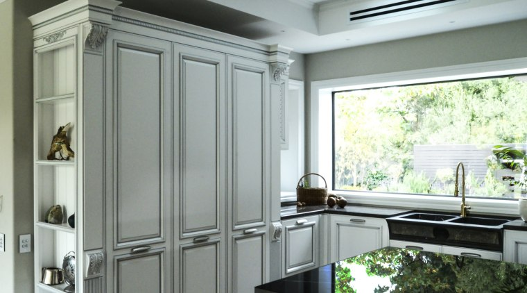 While this large kitchens panelled cabinet style is cabinetry, countertop, interior design, kitchen, window, gray