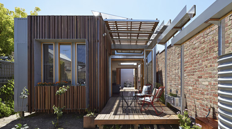 The Convertible Courtyards House by Christopher Megowan Design backyard, deck, facade, home, house, outdoor structure, property, real estate, siding, black