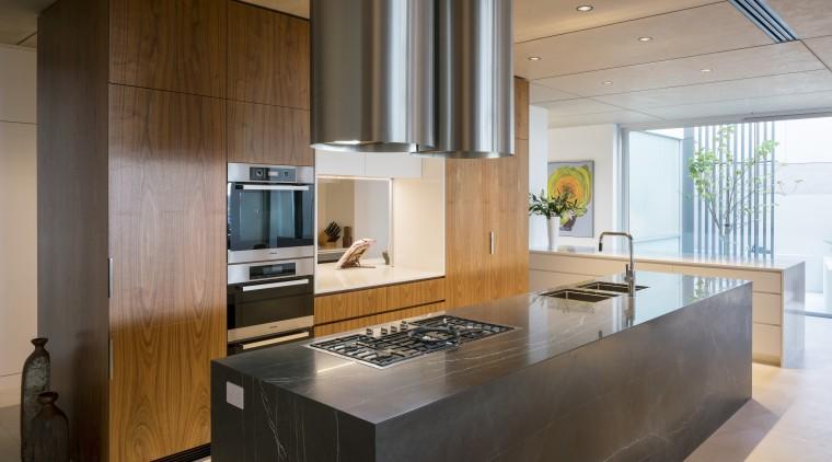 Stone, steel, wood and white quartz engineered stone cabinetry, countertop, cuisine classique, interior design, kitchen, real estate, brown