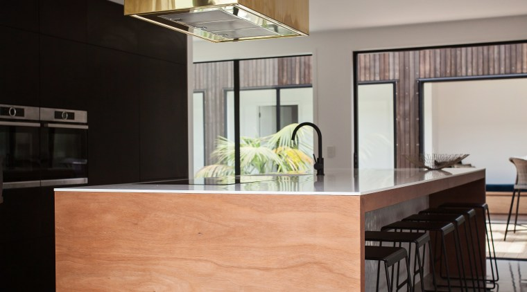 A matt black wall of perimeter cabinetry and architecture, cabinetry, chest of drawers, countertop, cuisine classique, furniture, interior design, kitchen, real estate, table, gray