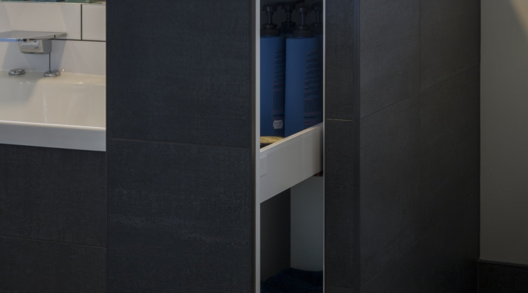 Compact storage includes a push action storage cabinet furniture, product design, black
