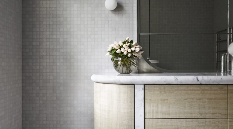 Carrara marble was used for the smooth, rounded bathroom, bathroom accessory, bathroom cabinet, ceramic, floor, flooring, furniture, interior design, product design, tap, tile, wall, gray, black