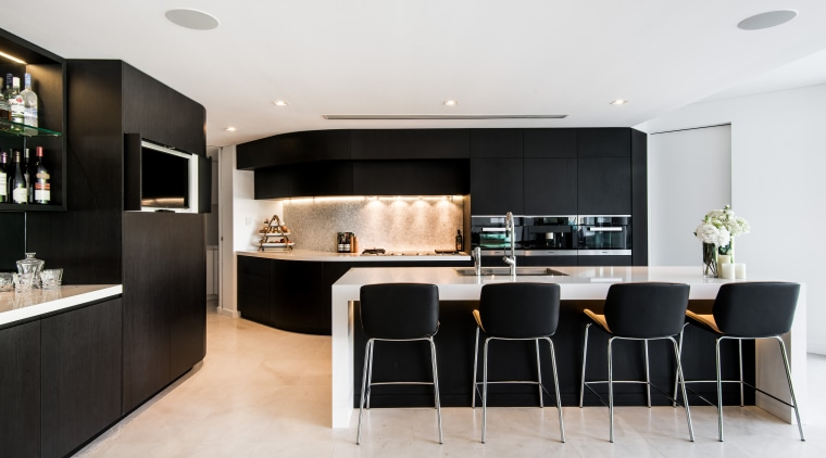This bar area sits at the side of interior design, kitchen, living room, room, white, black