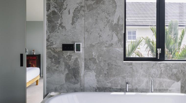 A floating vanity, toilet and bidet are teamed bathroom, bathtub, floor, glass, interior design, plumbing fixture, tap, gray