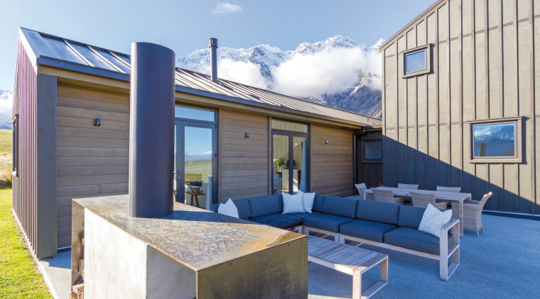 This GJ Gardner Queenstown home includes sheltered outdoor architecture, home, house, property, real estate, roof, teal