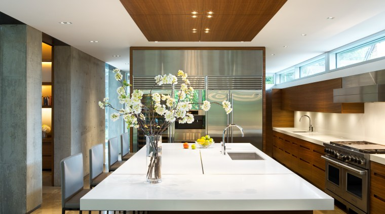 The main floor in this home is divided architecture, ceiling, countertop, house, interior design, kitchen, room, brown, white