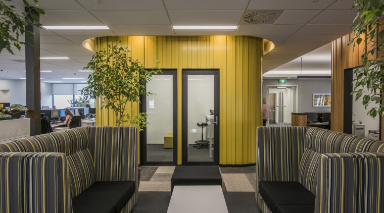 Beam me up this bright yellow pod appears interior design, lobby, gray, black
