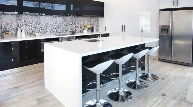 Crisp white Corian countertops and black high gloss countertop, floor, flooring, interior design, kitchen, product design, white