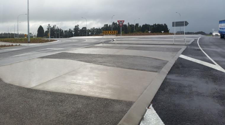 A traffic circle near Hamilton airport benefits from asphalt, lane, road, road surface, gray