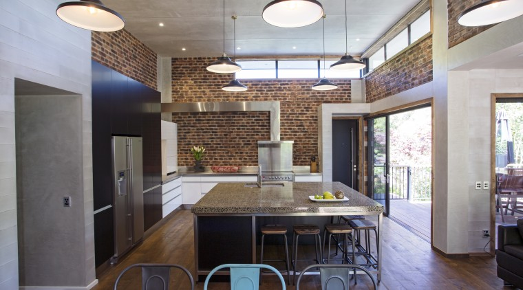 This island combines a concrete benchtop, Melteca cabinet architecture, ceiling, countertop, daylighting, interior design, kitchen, real estate, room, gray