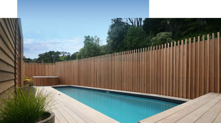 Executive Pools creates durable, aesthetically pleasing steel-reinforced concrete backyard, deck, fence, hardwood, leisure, outdoor furniture, outdoor structure, property, real estate, swimming pool, wood, wood stain, white
