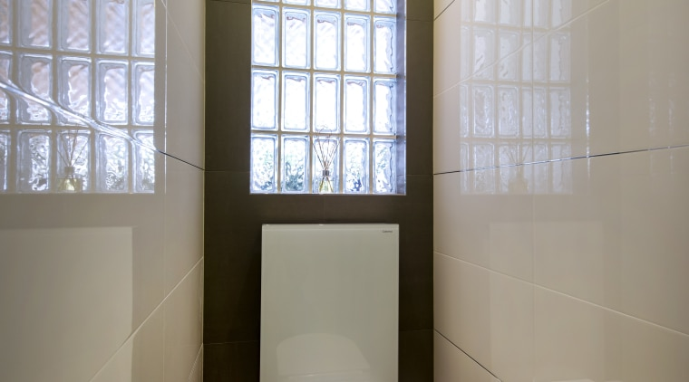 Multiple light sources bring this toilet space alive, architecture, bathroom, ceiling, daylighting, floor, home, interior design, plumbing fixture, room, toilet, toilet seat, window, gray