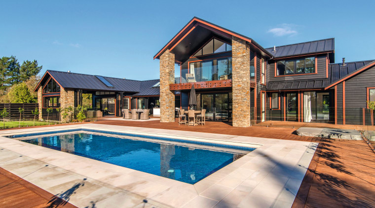 This residence benefits from windows and doors in cottage, estate, facade, home, house, property, real estate, residential area, siding, swimming pool, villa, teal