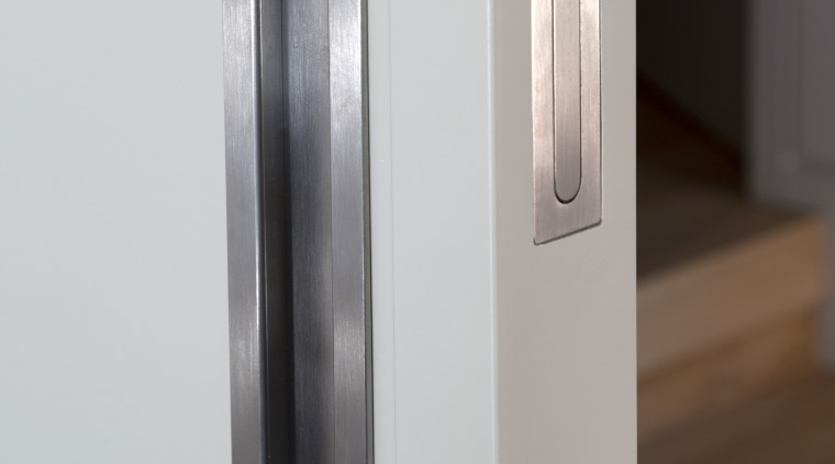 Flush stainless steel pulls from Chant complement doors door handle, product design, gray