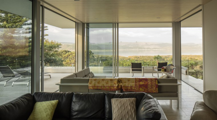 Connected to the land. Large-format sliding doors minimise architecture, home, house, interior design, living room, real estate, window, brown, black