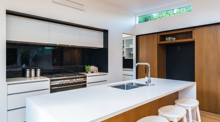A bulkhead heatpump is ideally positioned to discreetly interior design, kitchen, real estate, white, gray