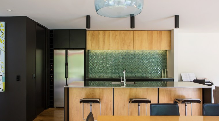 An oak-overlay floor grounds this kitchen by designer countertop, interior design, kitchen, product design, real estate, room, white