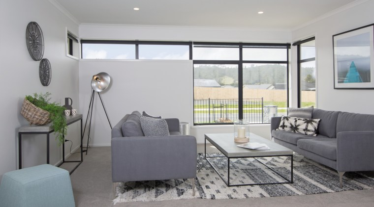 The interiors of this GJ Gardner home boast floor, home, house, interior design, living room, property, real estate, room, window, gray