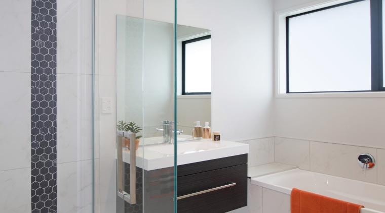 Modern and easy to clean, the main bathroom bathroom, bathroom accessory, bathroom cabinet, floor, interior design, plumbing fixture, product design, room, sink, gray