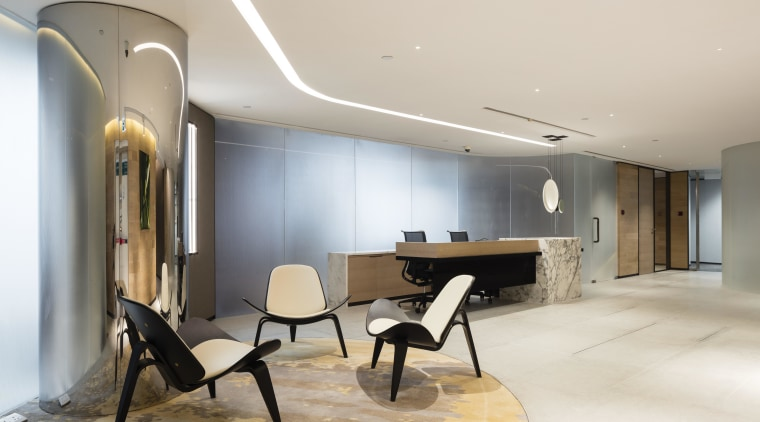 A structural column has been turned into an ceiling, floor, flooring, interior design, lobby, real estate, gray