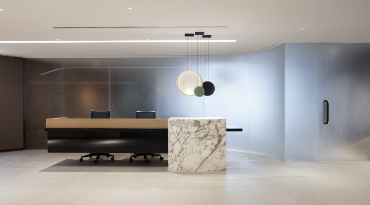 A dramatic cantilevered desk, designer lighting and a architecture, ceiling, floor, flooring, furniture, interior design, product design, wall, gray