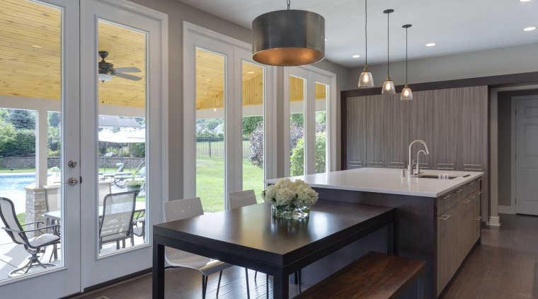 Floor-to-ceiling glazing sets this kitchen by designer Lauren countertop, dining room, interior design, kitchen, real estate, room, window, gray