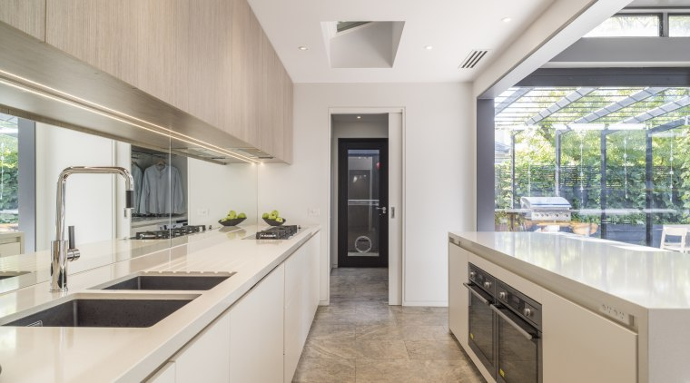 Pocket doors close off the laundry and pantry countertop, cuisine classique, estate, interior design, kitchen, property, real estate, gray