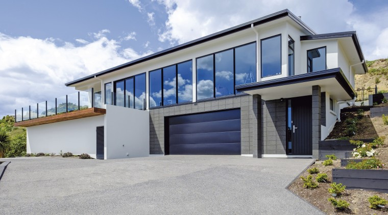 High-quality cladding, roofing and finishes protect this seaside architecture, building, elevation, estate, facade, home, house, property, real estate, residential area, window, gray