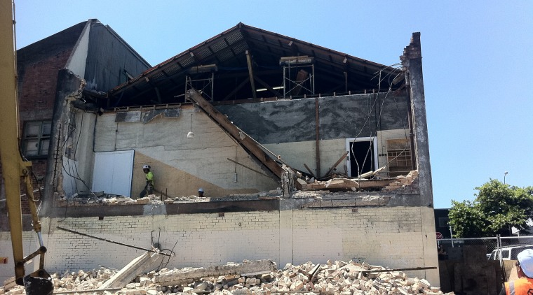 One wall of the historic Orange Hall was building, demolition, disaster, earthquake, house, roof, gray, teal, black