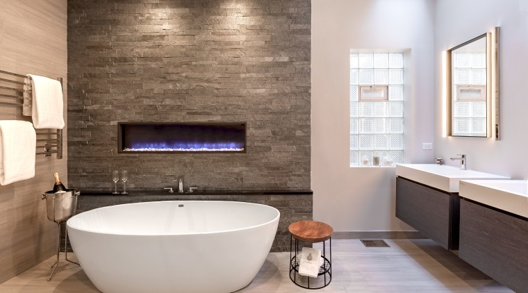 Stone-look tiles, an enclosed gas fire that changes bathroom, countertop, floor, flooring, home, interior design, plumbing fixture, room, sink, tap, tile, wall, gray